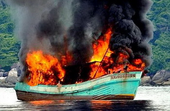 The Vietnamese fishing boats aflame.